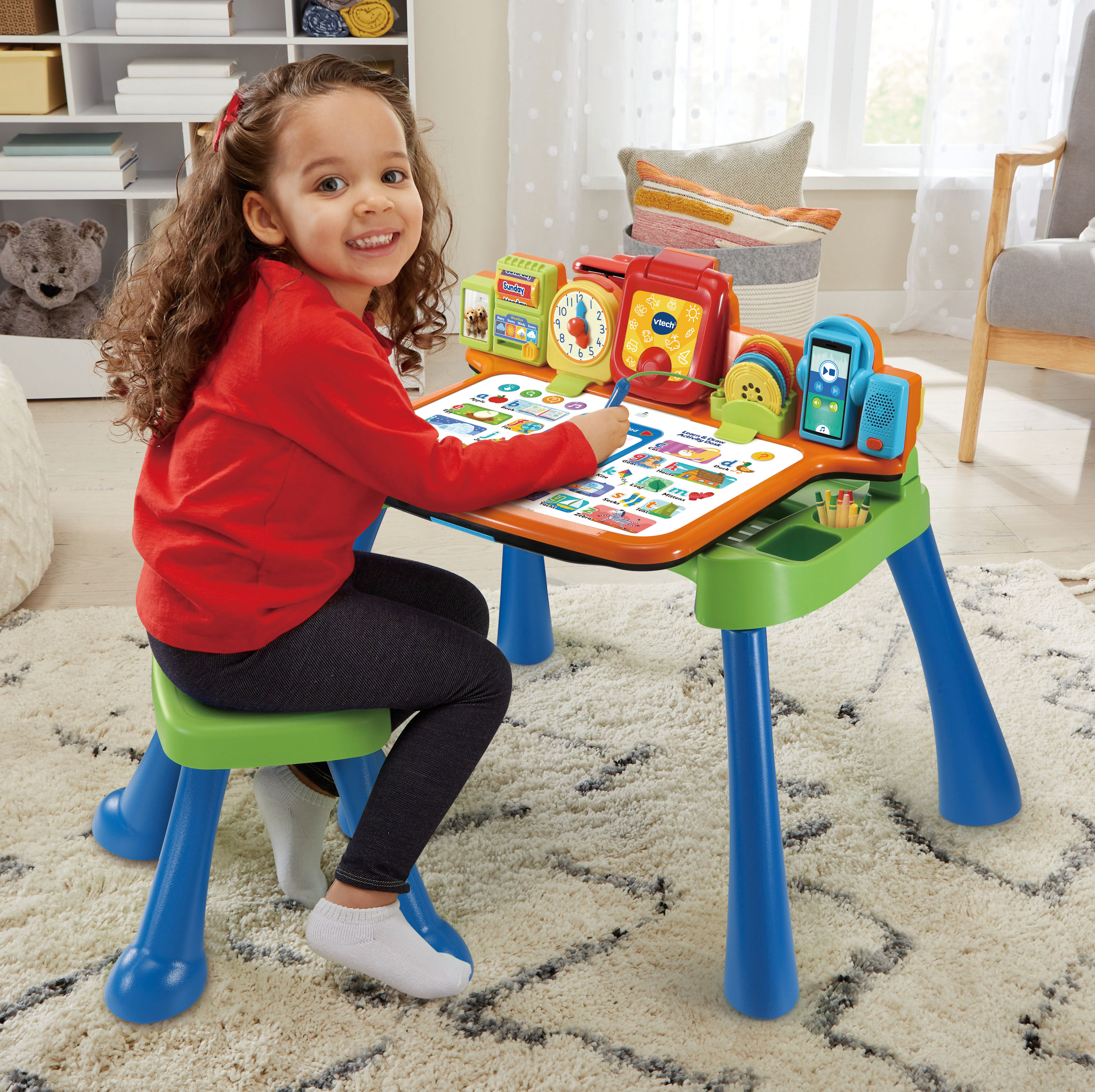 5-in-1 learning desk with stool includes an interactive desktop, projector, LED writing pad with stylus, chalk board and art station.